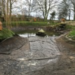 Refilling pond after some serious work.